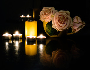 Still life of candles and flowers on the table