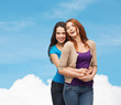 smiling teenage girls hugging