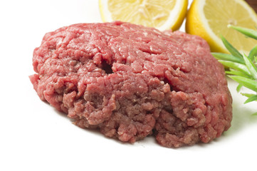 Minced horse meat with spice on the white
