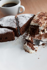 Homemade Belgium chocolate cake with a cup of coffee