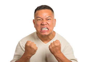angry middle aged man with open mouth fist up in air