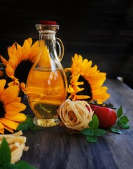 Sunflowers, pasta, tomatoes, basil and a bottle of oil