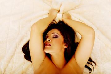 Young sensual woman having orgasm.