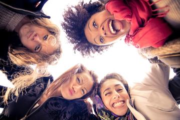 Four young beautiful girls smiling