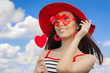 Girl with Heart Sunglasses and, Lollipop and a Straw Hat