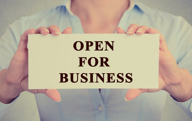 businesswoman hands holding sign message open for business