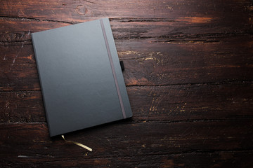 Notepad laying on a old dark wooden table