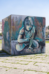 Graffti on a cube of a girl