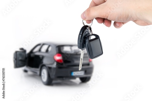 Hand holding keys to new car. Buy or selling business compositio - 76338701