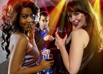 women seducing a man at a bar or nightclub