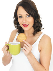 Young Woman with a Mug of Tea and Biscuit