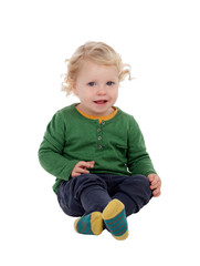 Adorable blond baby sitting on the floor