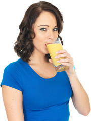 Happy Young Woman Drinking Fruit Juice