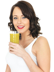 Attractive Young Woman Drinking Mango Juice