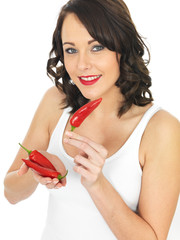 Young Woman Holding Red Chillies