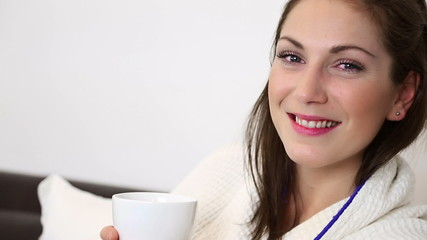 Attractive woman smelling her coffee cup