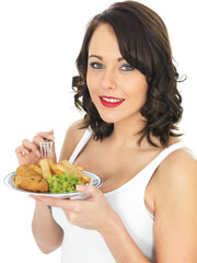 Young Woman Eating Fish and Chips
