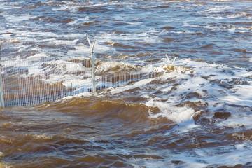 raging river runs onto concrete slabs