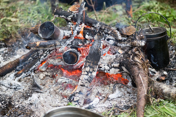 cans in fire and  pot