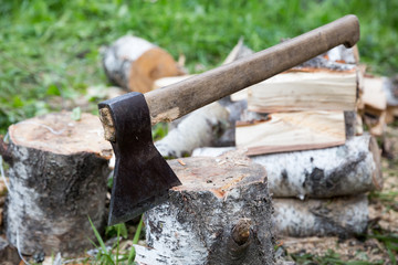 birch logs and axe