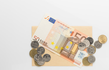 Euro banknotes and coin on white background