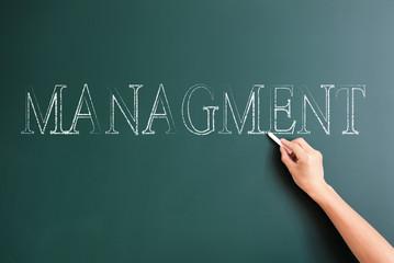 management written on blackboard