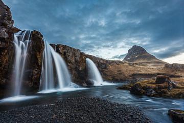 kirkjufellsfoss  waterfalls and kirkjufell mountain in the morni