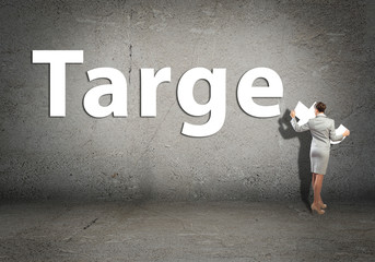 young businesswoman adds target word