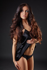 Image of charming brunette advertises underwear