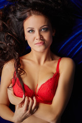 Portrait of woman in lingerie smiling at camera