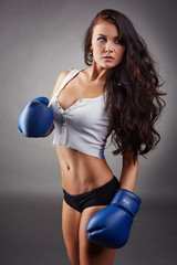Studio shot of sexy girl in boxing gloves