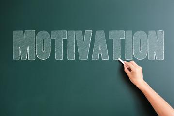 motivation written on blackboard