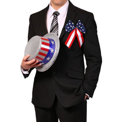Businessman holding Hat with American Flag isolated on white