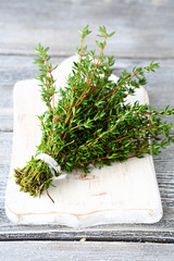Fragrant thyme on a white chopping board
