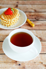 Black tea and Waffles with strawberries