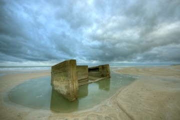 Remains of bunker in the beach