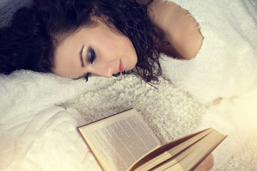 Relaxed girl reading a book