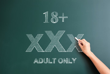 18 plus adult only written on blackboard