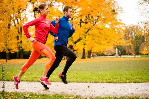 Fototapeta Couple jogging in autumn nature