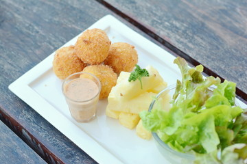 Fried Loaded Mashed Potato Balls and salad
