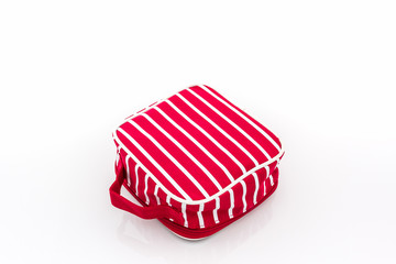 Red makeup bag on white background.