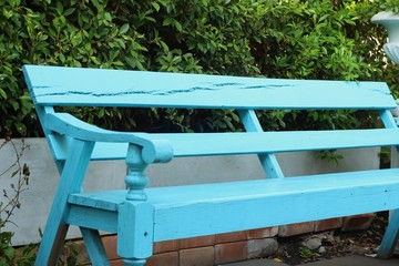 Blue seat in a garden at the park