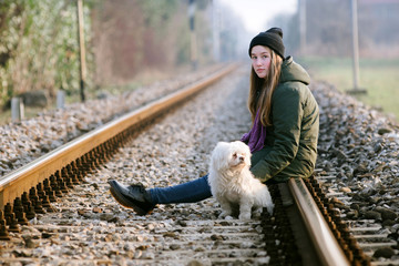 girl with the dog on the railway