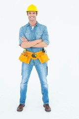 Carpenter standing arms crossed over white background