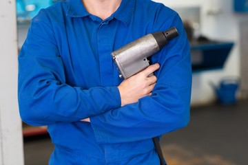 Mechanic holding a drill tool
