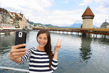 Tourist selfie woman in Lucerne Switzerland