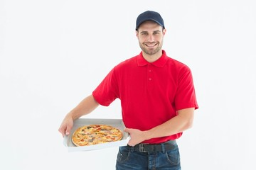 Happy delivery man holding fresh pizza