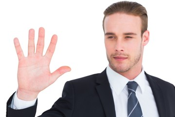 Cheerful businessman with hand raised