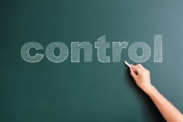 control written on blackboard