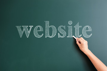 website written on blackboard